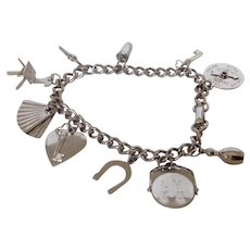 Vintage Coro Silvertone Charm Bracelet with 10 Charms Some Mechanical and an Eames Style Chair