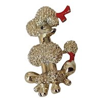 Playful vintage poodle pin with red bows