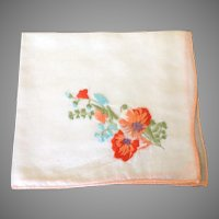 Vintage handkerchief with brightly embroidered flowers