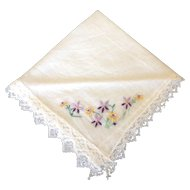 Vintage lace edged handkerchief with hand embroidered purple and yellow flowers
