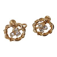 Rhinestone trefoil gold tone screwback earrings.