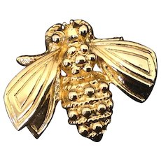 Gold tone fly or bee pin marked DP