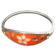 Alpaca Mexico silvertone hinged bracelet with Mother of Pearl, abalone and wire inset into orange enamel background