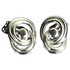 Trifari Silver Tone Entwined Circles Clip Earrings.