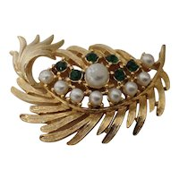 Gerry's flowing leafy branch pin set with simulated pearls and green rhinestones in goldtone setting.