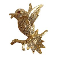 Bird on a branch gold tone and rhinestone pin