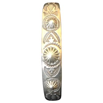 Southwest Narrow Cuff Bracelet with Repousse and Stamped Designs.