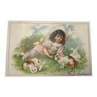 1907 Undivided back  Easter postcard with girl and bunnies
