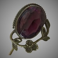 Vintage stick pin with faceted purple glass stone
