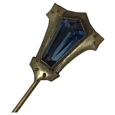 Vintage stick pin with tapered blue glass stone in Art Deco style setting