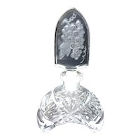 Perfume bottle with tall arched stopper with grapes