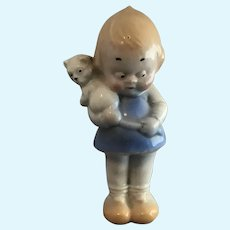 Bisque German Character Figurine Girl with Googly Eyes holding Cat by the tail