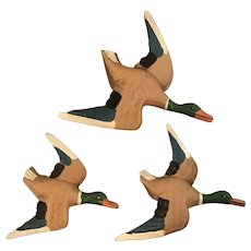 Vintage ducks flying in formation.