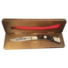 Vintage Camillus USA Craftsman 65th Anniversary Special Edition folding knife in wooden presentation box.