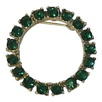Circle pin with vibrant green rhinestones