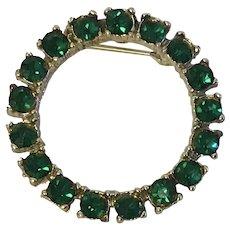 Circle pin with vibrant green rhinestones