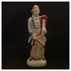 Colonial man with cello figurine  Japan glazed bisque figurine