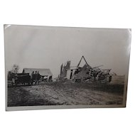 Unused Real Photo Postcard with Men Surveying Collapsed Barn After a Storm