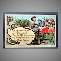 Postcard Santa in Blue Robe and Driving an Automobile