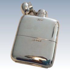 1909 Sheffield Elkington and Co. silver hip flask.