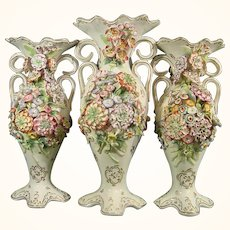 Mantle Garniture of Three Vases Encrusted with Flowers C.1825.