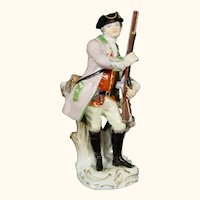 Meissen Figure of Hunter Holding His Rifle in 18th-Century Uniform, late 19th to early 20thc.