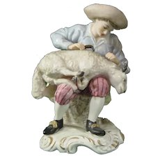 Late 19th century French Figure of a Shepherd Shearing a Sheep.