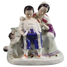 French Antique 19thc. Porcelain Figure Group of a Mother, Child and Dog.