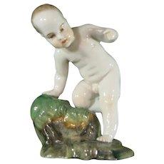 Hochst Damm or Passau Continental Porcelain Figure, Boy on a Grassy Base 19th Century.