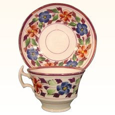 Staffordshire Bone China Pink Luster Cup and Saucer with a Crook Handle c.1815.