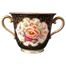 Bold Minton Two-Handled Chocolate or Sorbet Cup with Flower Decoration on a Cobalt Blue Ground, Pattern 678, c.1820.