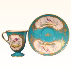Sevres Blue Ground Sorbet Cup and Saucer, Decorated with a Bird and Flowers.