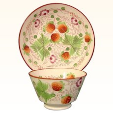 Staffordshire Antique Cup and Saucer in a Strawberry Pattern c.1825.