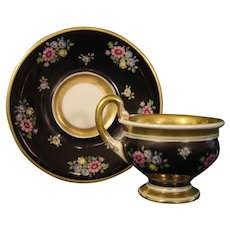 Bavarian Empire Style Cup and Saucer with Black Ground and Colorful Flowers.