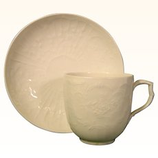 KPM Berlin Molded Cup and Saucer with Rococo Scrolls.
