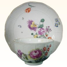 Meissen C.1750 Cup and Saucer Decorated with Lively Flowers