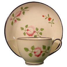 A Wedgwood Miniature Creamware Teacup and Saucer Decorated with Sprays of Roses c.1800.
