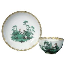 Early Meissen Antique Green Watteau Cup and Saucer c.1740-45.