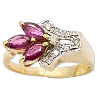 Unique 14kt Yellow Gold Vintage Sparkling Diamond and Marquise Shaped Ruby Ring is set in an East and West Design. Size 5, Can be resized.