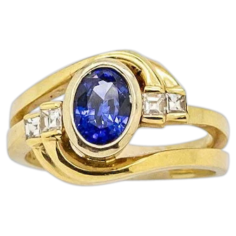 Beautiful Vintage Oval Bezel Set Sapphire with Square Baguette Diamond Accents are set Gracefully in this Swirl Design 14kt Yellow Gold Ring, Size 6, easily sized.