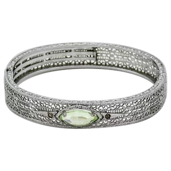 Vintage Filigree Silver Tone Hinged Bangle Bracelet with Pale Green Synthetic Spinel, flanked by two Rhinestones, Circa 1920's. Very well made!