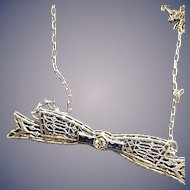 Art Deco Diamond and Synthetic Sapphire Bow Pendant in 10KT White Gold on a Sterling Chain