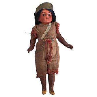Armand Marseille Scowling Indian, all original. Has seen battle!