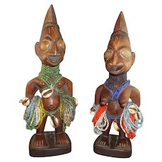 A Pair of Nigerian Yoruba Twin Figures, Adorned with Native Beads & Shells