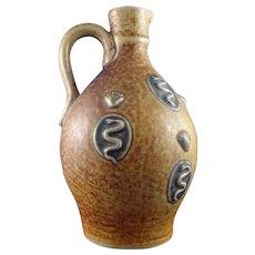 Continental Stoneware Bellarmine Style Jug, Shell & Serpent Slip Decoration