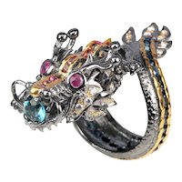 A Sterling Silver Sapphire and Ruby Dragon Ring