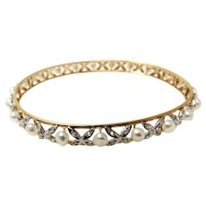 Edwardian black starr and frost pearl and diamond bangle.