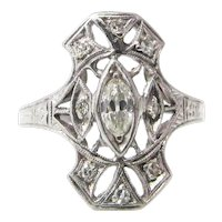 Intriguing  Art Deco .50 CTW Diamond Platinum Engagement Alternative Ring