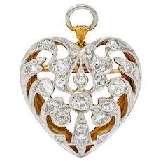 Edwardian 0.90 CTW Diamond Platinum-Topped 14 Karat Gold Heart Pendant Brooch