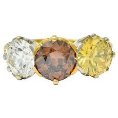 Edwardian 4.31 CTW Diamond & Fancy Diamond 18 Karat Gold Platinum Three Stone Ring